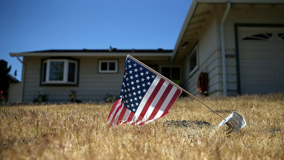 FREMONT, CA - JULY 18:  An American flag is displayed on a dead lawn in front of a home on July 18, 2014 in Fremont, Californ