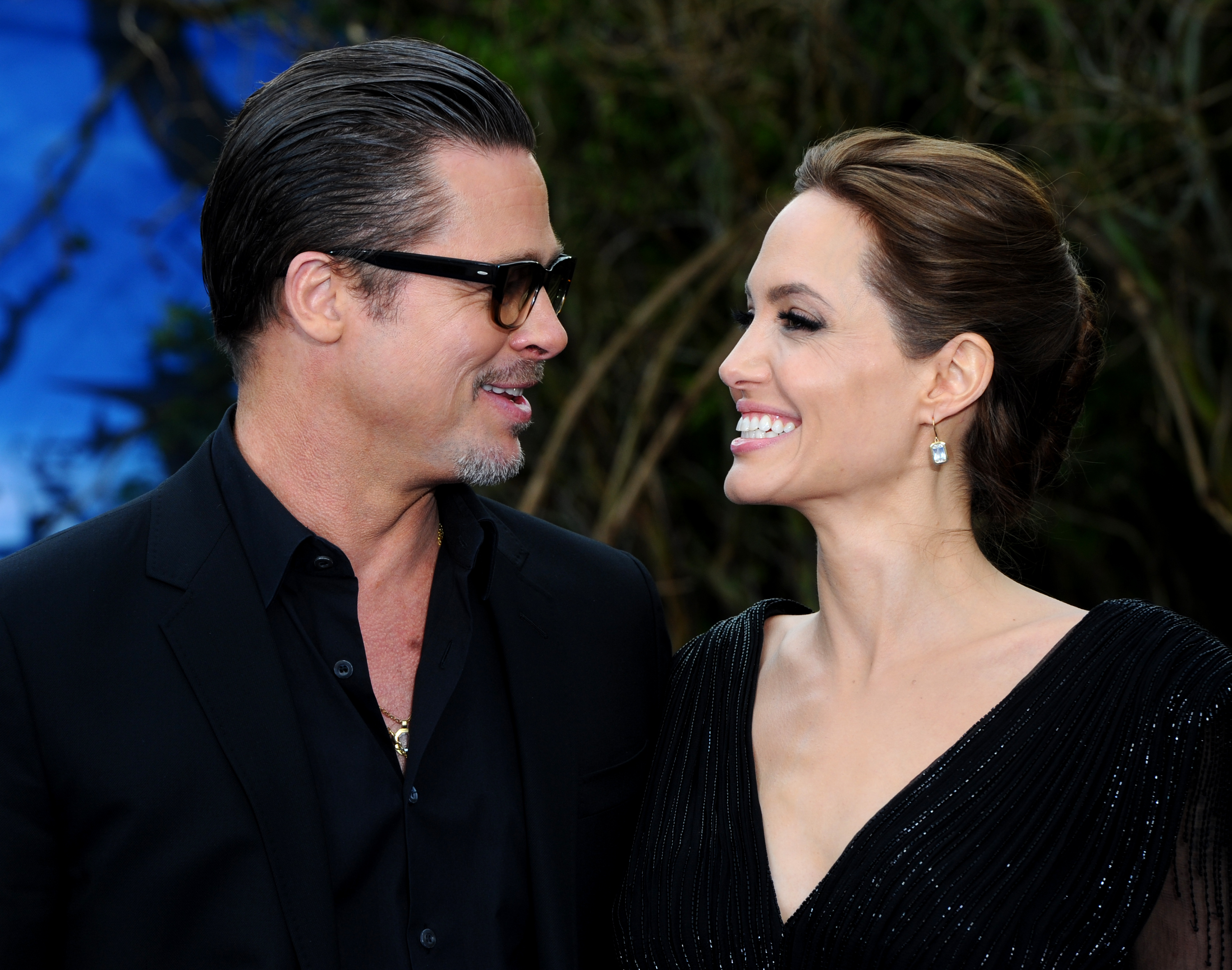 LONDON, ENGLAND - MAY 08:  Brad Pitt and Angelina Jolie attend a private reception as costumes and props from Disney's 'Malef