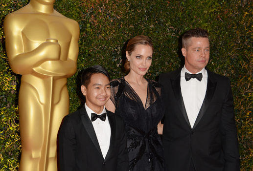 Angelina Jolie, Maddox Jolie-Pitt und Brad Pitt 2013 in Hollywood