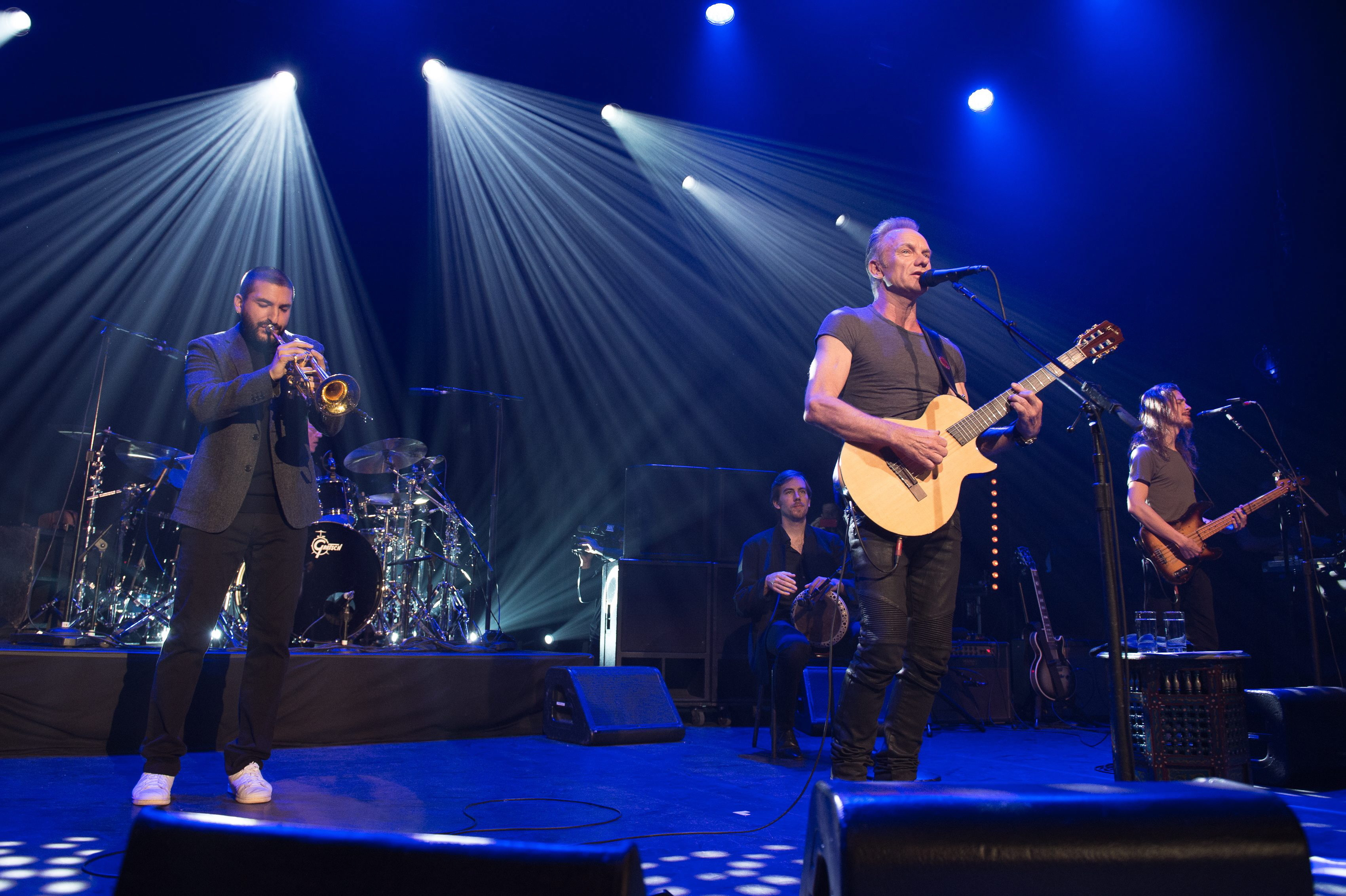 epa05629051 A handout image provided by the Bataclan managment shows British musician Sting (C) during his concert at the new