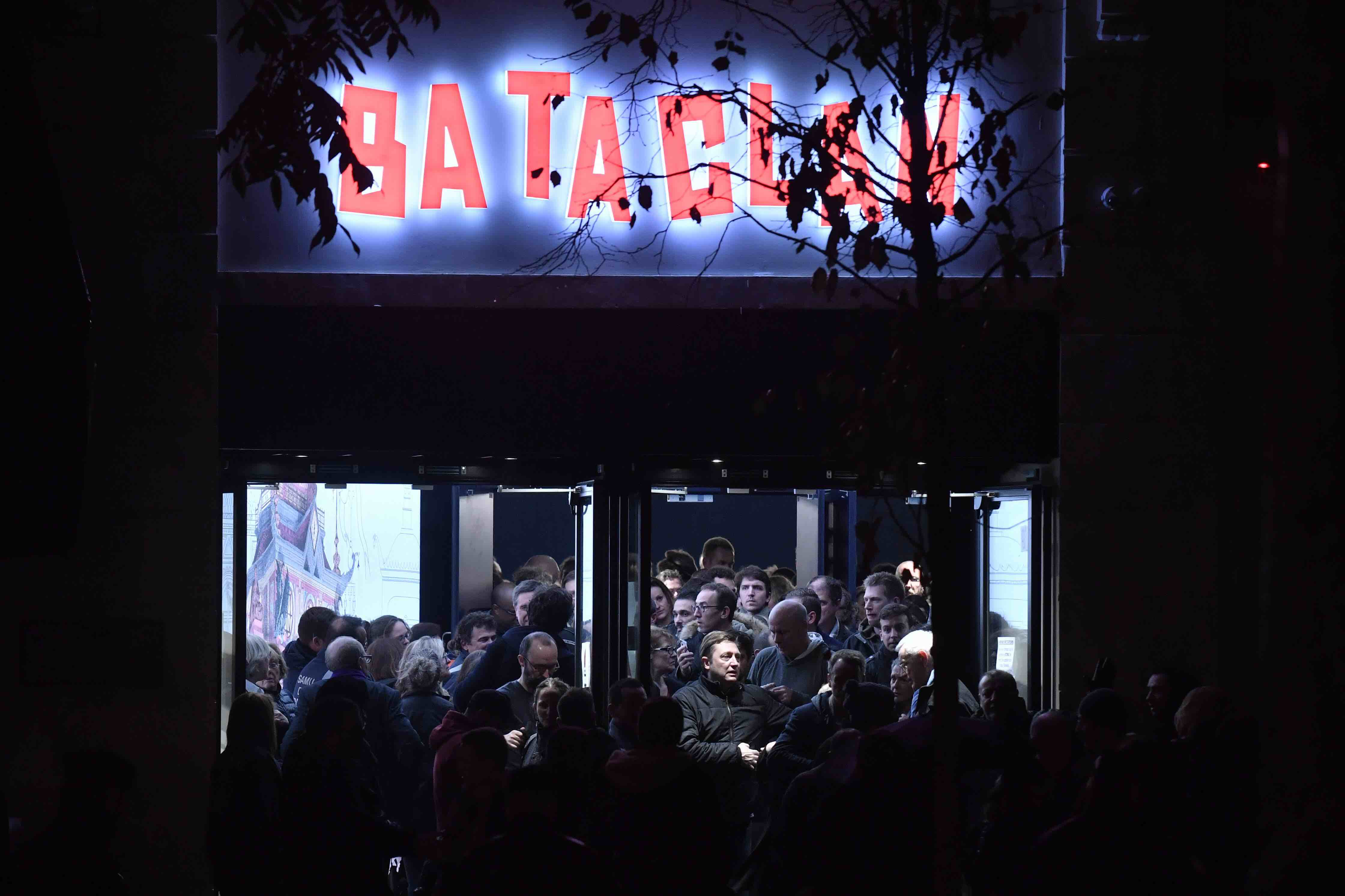 People leave the Bataclan concert hall in Paris on November 12, 2016, after the reopening concert by British musician Sting t