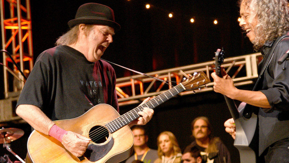 MOUNTAIN VIEW, CA - OCTOBER 23:  Neil Young and Kirk Hammett of Metallica perform during the 30th Anniversary Bridge School B