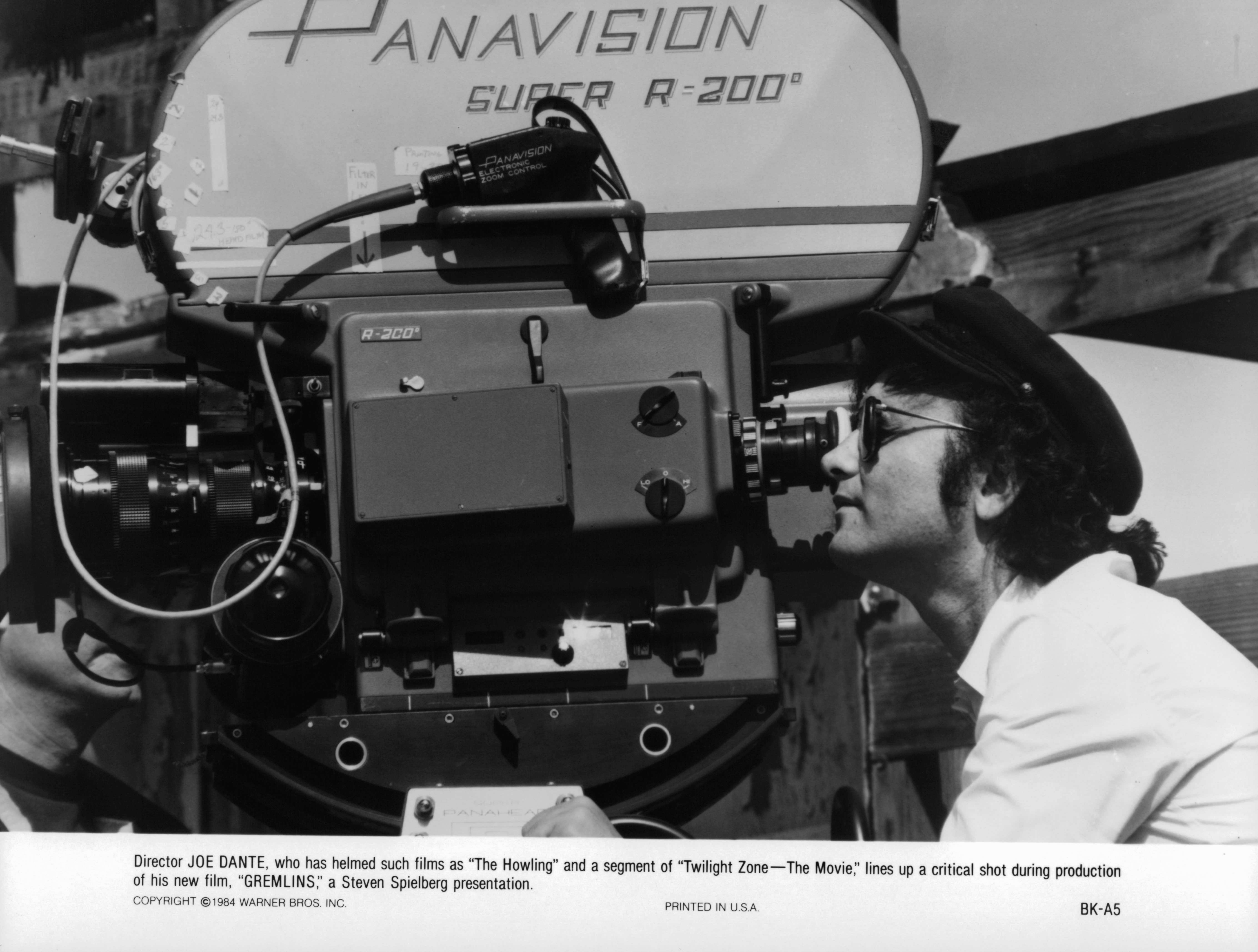 Director Joe Dante lines up a critical shot during production of 'Gremlins', 1984. (Photo by Warner Brothers/Getty Images)