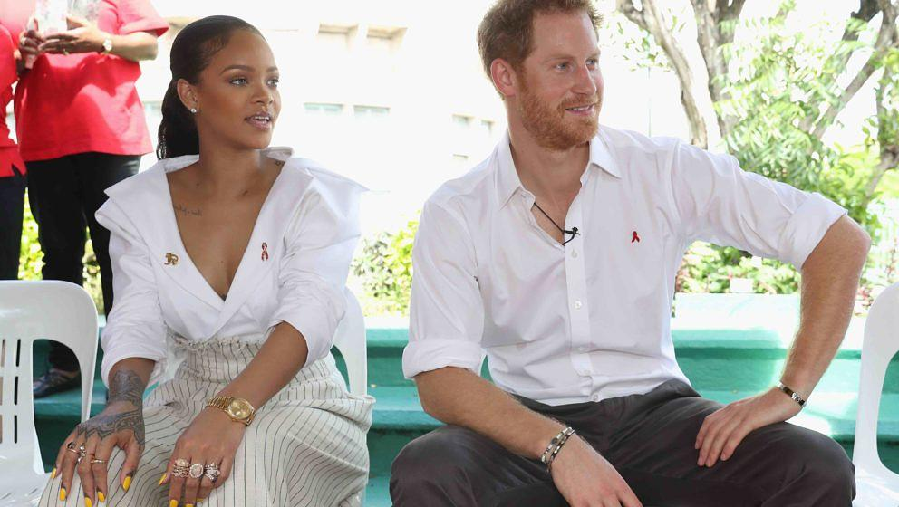BRIDGETOWN, BARBADOS - DECEMBER 01:  Rihanna and Prince Harry attend the 'Man Aware' event held by the Barbados National HIV/
