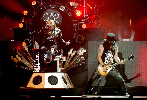 INDIO, CA - APRIL 16:  Musician Axl Rose and Slash of Guns N' Roses performs onstage during day 2 of the 2016 Coachella Valle