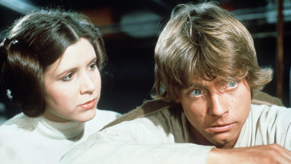 CA.Star Wars1.0124.4. Princess Leia (Carrie Fisher) comforts Luke Skywalker (Mark Hamill) after the disappearance ofBen Kenob