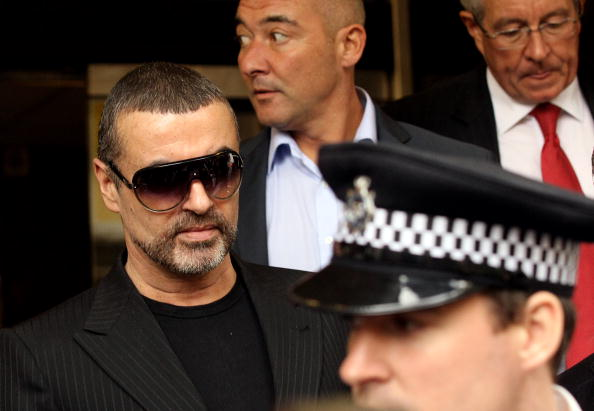 LONDON, ENGLAND - AUGUST 24:  Singer George Michael (L) leaves Highbury Corner Magistrates Court on August 24, 2010 in London