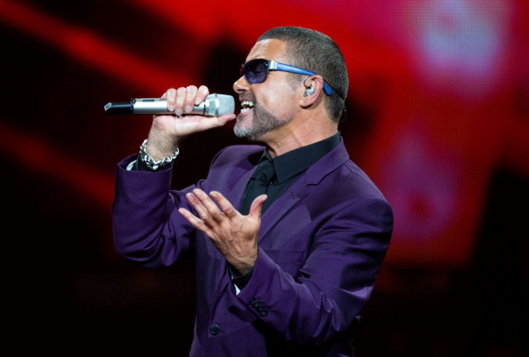 LONDON - SEPTEMBER 29:  George Michael peforms at the Royal Albert Hall on September 29, 2012 in London, England. (Photo by S