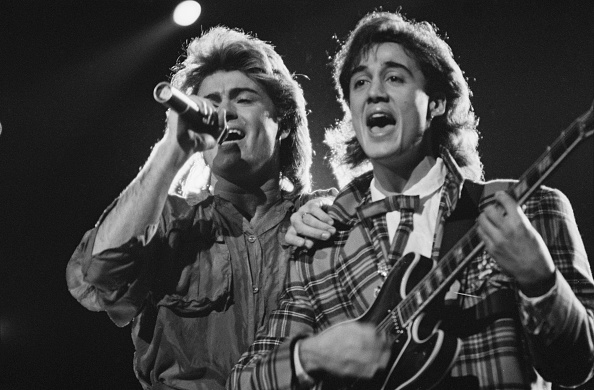 George Michael (left) and Andrew Ridgeley of Wham! performing during the pop duo's 1985 world tour, January 1985. 'The Big To
