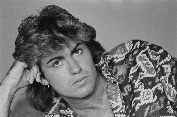 British singer-songwriter George Michael, of Wham!, in a Sydney hotel room during the pop duo's 1985 world tour, January 1985