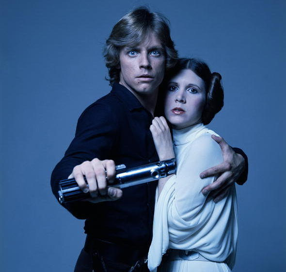 American actors Mark Hamill and Carrie Fisher in costume as brother and sister Luke Skywalker and Princess Leia in George Luc