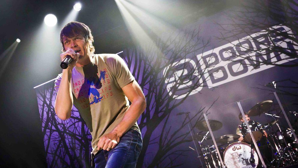 BERLIN, GERMANY - OCTOBER 19 Singer Brad Arnold of the American band 3 Doors Down performs live during a concert at the Colum