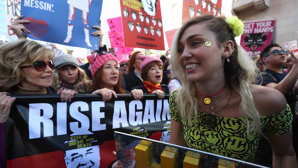 LOS ANGELES, CA - JANUARY 21:  Singer Miley Cyrus (R) marches during the Women's March on January 21, 2017 in Los Angeles, Ca