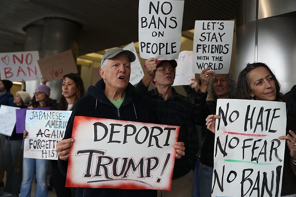 MIAMI, FL - JANUARY 29:  Protesters stand together at the Miami International Airport against the executive order that Presid