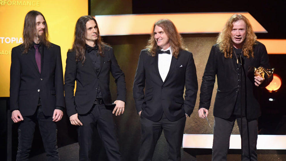 LOS ANGELES, CA - FEBRUARY 12:  Musician Dave Mustaine (holding trophy) and fellow members of Megadeth accept the Best Metal