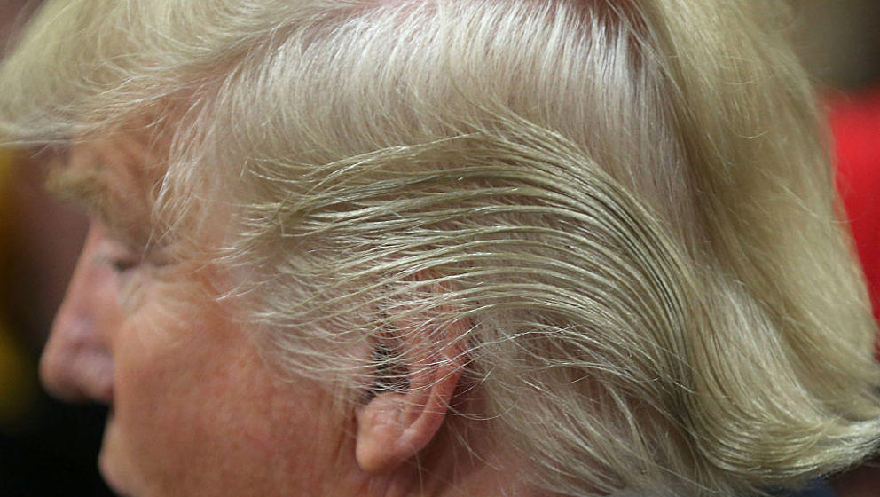 COUNCIL BLUFFS, IA - JANUARY 31:  Detail of Republican presidential candidate Donald Trump's hair as he signs autographs afte
