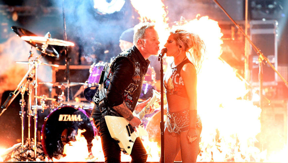 LOS ANGELES, CA - FEBRUARY 12:  Recording artists James Hetfield (L) of music group Metallica and Lady Gaga perform onstage d