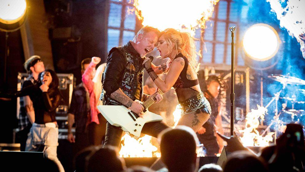 LOS ANGELES, CA - FEBRUARY 12:  Musicians James Hetfield of Metallica and Lady Gaga during The 59th GRAMMY Awards at STAPLES