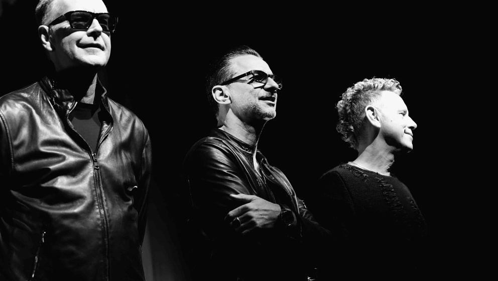 MILAN, ITALY - OCTOBER 11:  (EDITORS NOTE: Image has been converted to black and white.) Depeche Mode attend a photocall to l