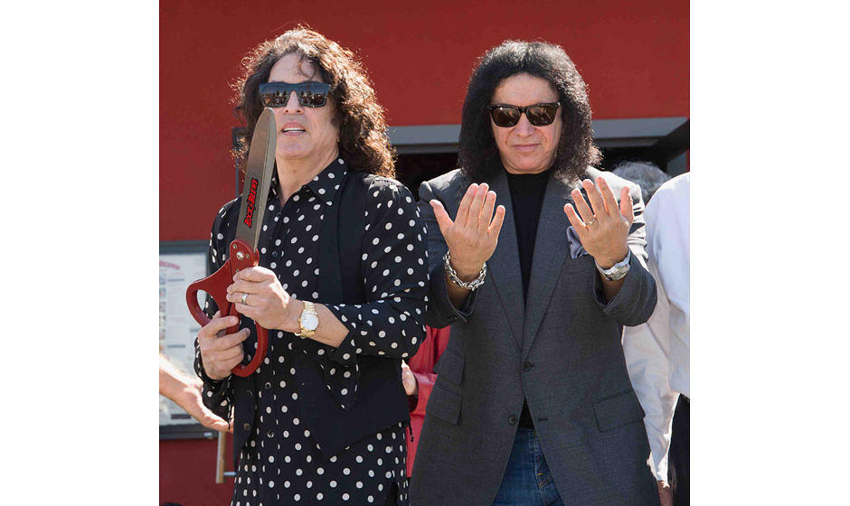 CORONA, CA - OCTOBER 18:  Paul Stanley and Gene Simmons attend the ribbon cutting ceremony during the official grand opening