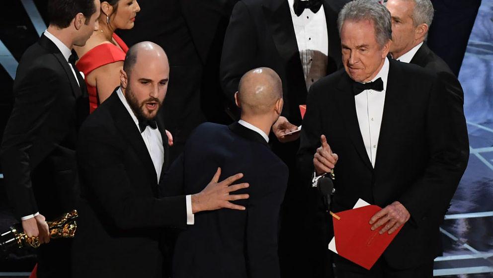 'La La Land' producer Jordan Horowitz (L) celebrates next to US actor Warren Beatty (R) after the latter mistakingly read 'La