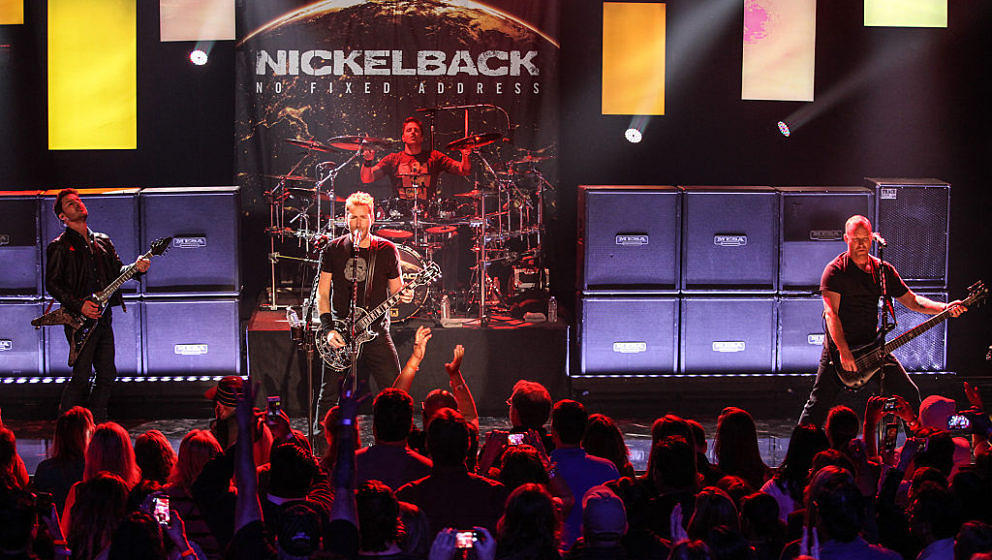 BURBANK, CA - NOVEMBER 18:  (L-R) Musicians Ryan Peake, Chad Kroeger, Daniel Adair and Mike Kroeger of Nickelback perform at