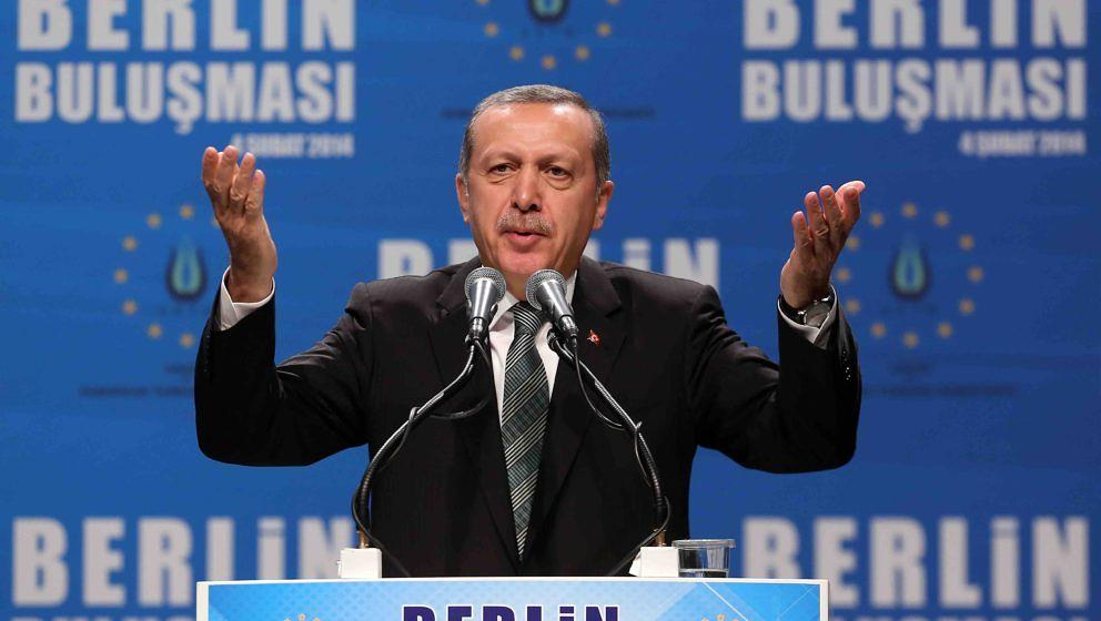 Turkish Prime Minister Recep Tayyip Erdogan speaks to supporters at a rally at Tempodrom hall on February 4, 2014 in Berlin,