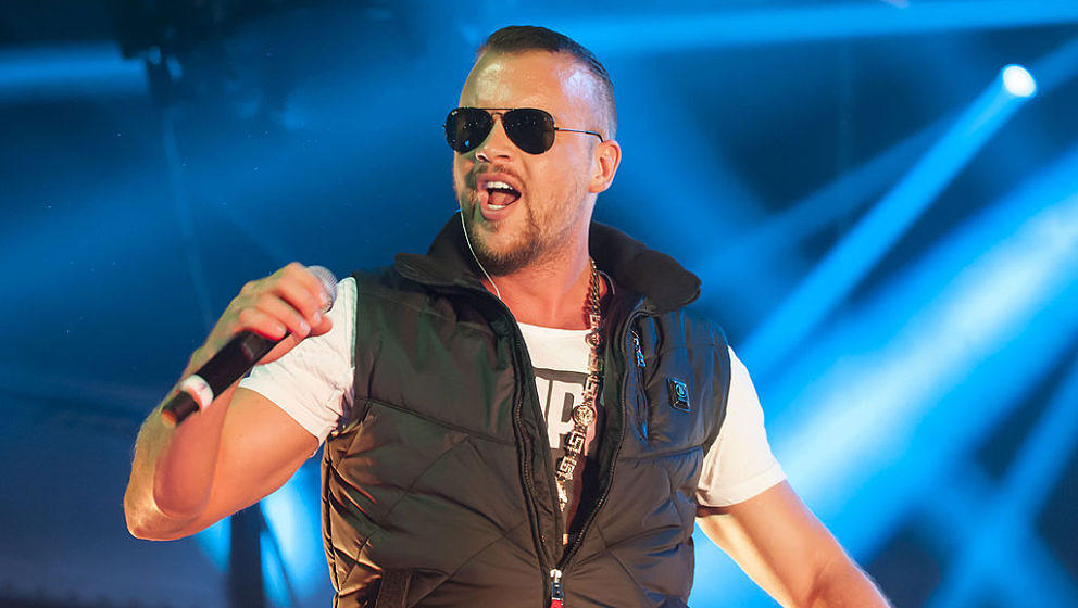 COLOGNE, GERMANY - SEPTEMBER 13: German rapper Kollegah performs during his 'King Tour' at the Palladium on September 13, 201
