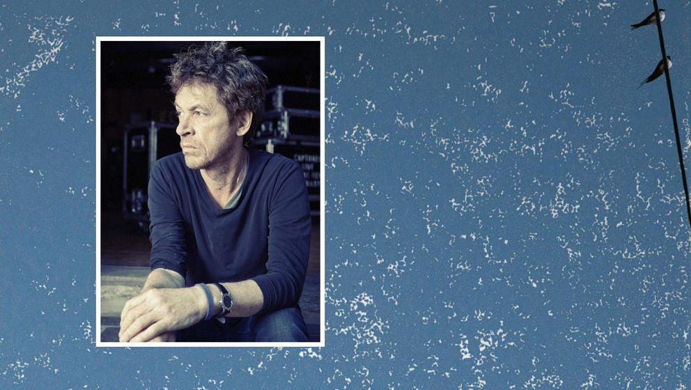 """Dominic Miller (im Hintergrund das Cover zu seiner neuen Platte """"Silent Light"""")"""