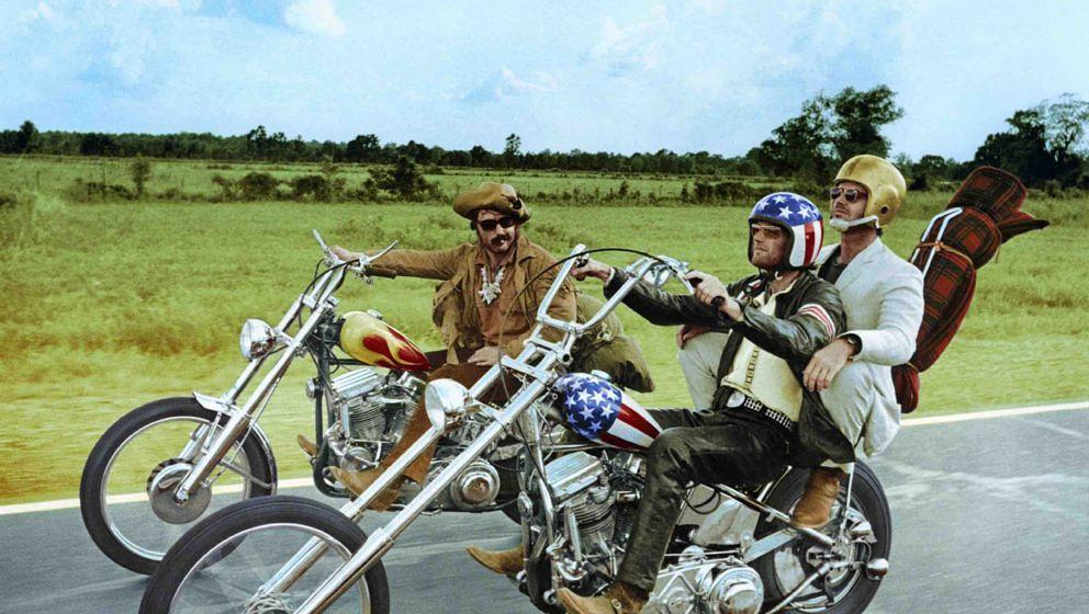 Dennis Hopper (1936-2010), US actor, and Peter Fonda, wearing a stars-and-stripes helmet, riding their chopper motorcycles, w