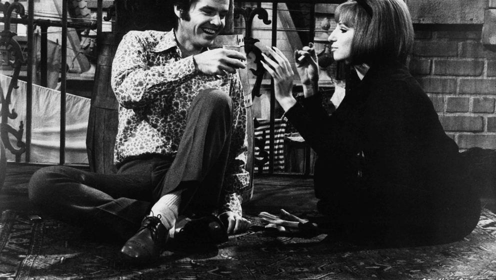 Jack Nicholson and Barbra Streisand sharing time together on the roof in a scene from the film 'On A Clear Day You Can See Fo