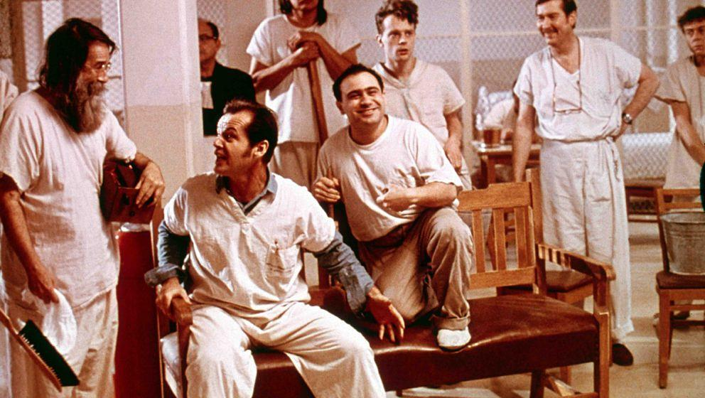 1975:  American actor Jack Nicholson and others share a laugh in a still from the film, 'One Flew Over the Cuckoo's Nest,' di