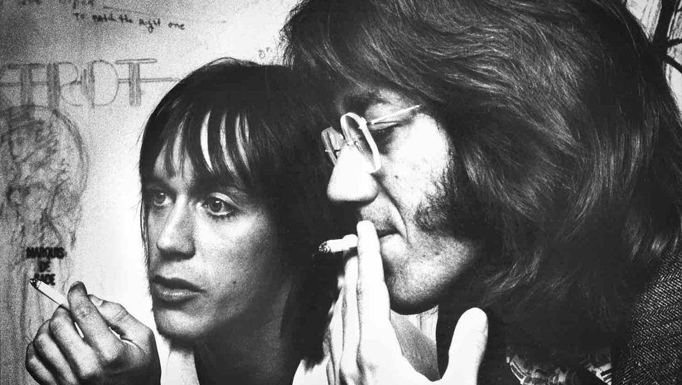 LOS ANGELES - JANUARY 01: Iggy Pop (left) and Ray Manzarek from The Doors (right) (1939-2013) smoke cigarettes backstage at t