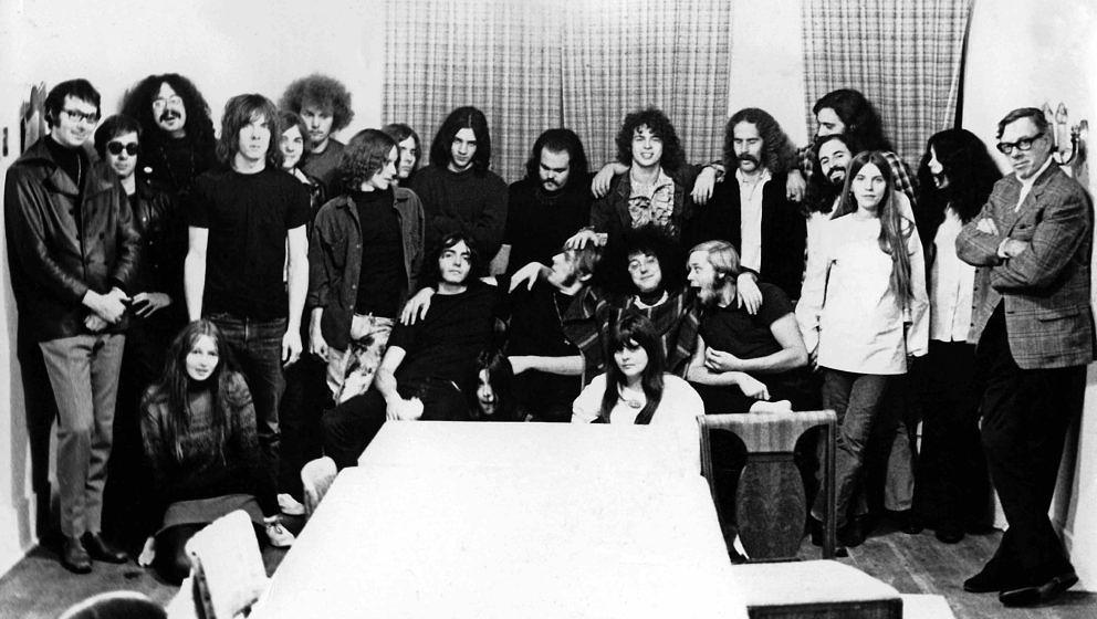 ANN ARBOR, MI - October 1968:  Rock groups MC5 and The Stooges pose for a photo with friends and record executives as they bo