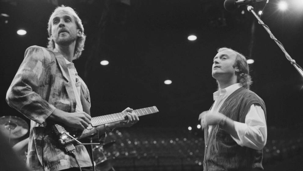 Mike Rutherford (left) and Phil Collins performing with English rock group Genesis, at the Rosemont Horizon, Rosemont, Illino
