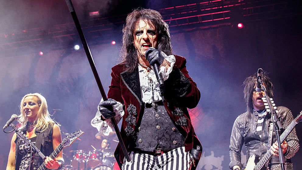 VANCOUVER, BC - OCTOBER 19:  Singer-songwriter Alice Cooper (middle) performs onstage at Queen Elizabeth Theatre on October 1