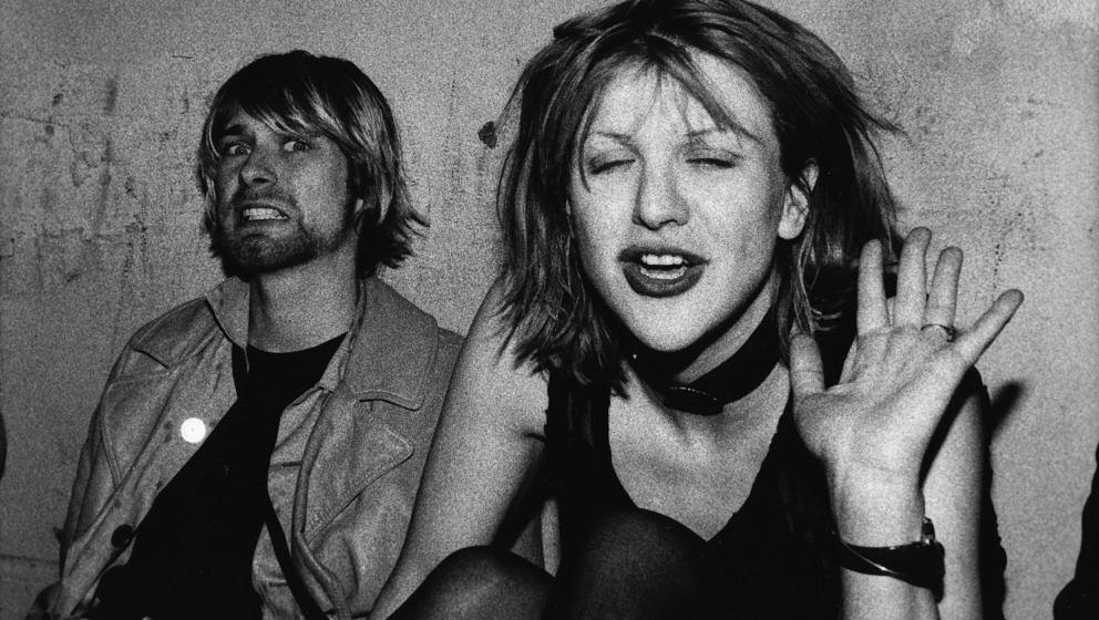 LOS ANGELES - SEPTEMBER 27:  Singer Kurt Cobain (L) of the rock group Nirvana and Courtney Love of Hole on VIP balcony of The