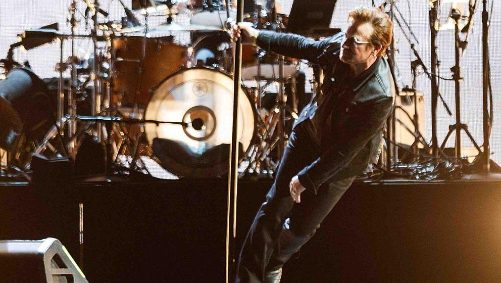 VANCOUVER, BC - MAY 12:  (L-R) Larry Mullen Jr. and Bono of rock band U2 perform on stage during their 'The Joshua Tree World