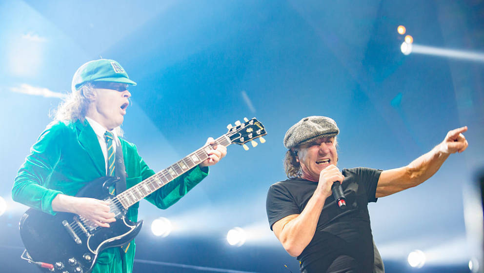 KANSAS CITY, MO - FEBRUARY 28: Musician Angus Young (L) and singer Brian Johnson of AC/DC performs at Sprint Center on Februa