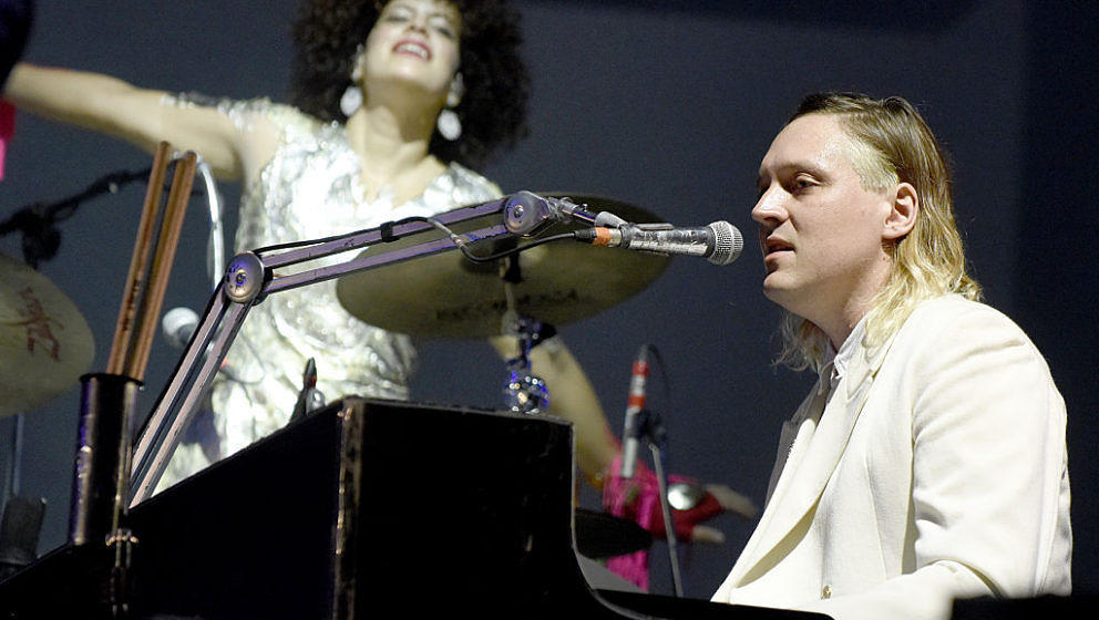 NEW ORLEANS, LA - OCTOBER 30:  Regine Chassagne (L) and Win Butler of Arcade Fire perform during the Voodoo Music + Arts Expe