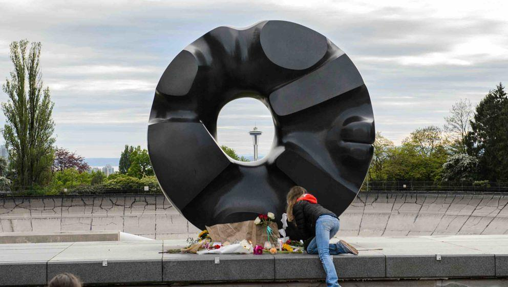 SEATTLE, WA - MAY 18:  Fans gather at an impromptu memorial created at the Black Sun sculpture in Volunteer Park to honor Chr