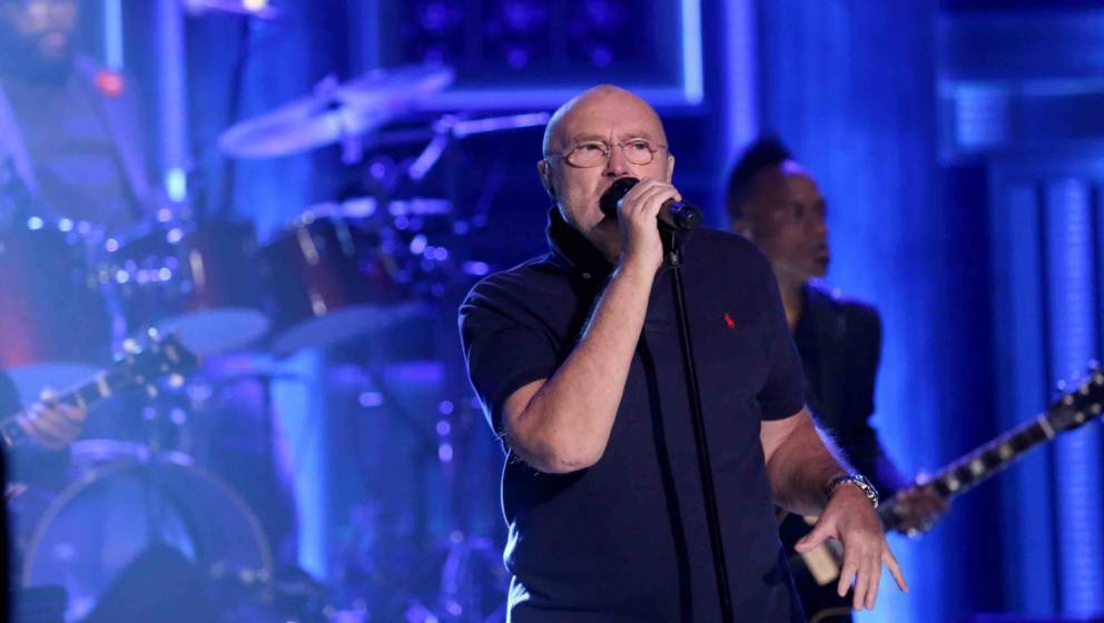 THE TONIGHT SHOW STARRING JIMMY FALLON -- Episode 0557 -- Pictured: Musical guest Phil Collins with The Roots perform on Octo