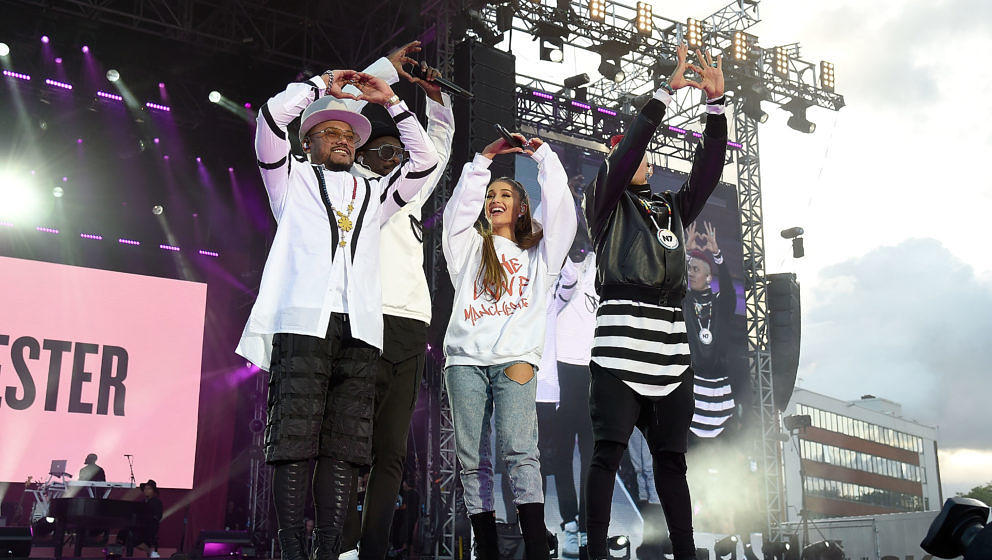 MANCHESTER, ENGLAND - JUNE 04:  Ariana Grande performs on stage with apl.de.ap (L) will.i.am (2nd L) and Taboo of The Black E