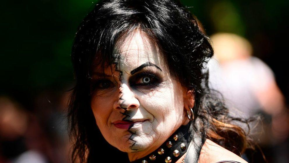 A dressed up woman attends a so-called 'Victorian Picnic' during the Wave-Gotik-Treffen (WGT) festival in Leipzig, eastern Ge