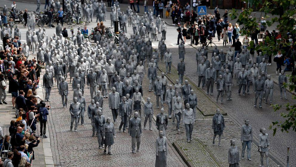 HAMBURG, GERMANY - JULY 05:   Prostestors dressed-up in grey clothes like Zombies attend an arts performance called '1000 Ges