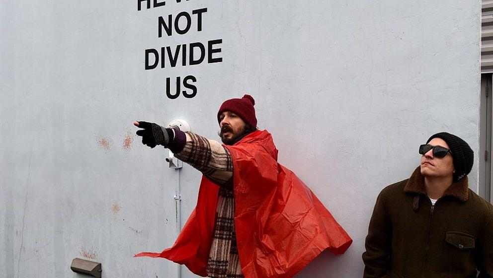 US actor Shia LaBeouf(L) during his He Will Not Divide Us livestream outside the Museum of the Moving Image in Astoria, in th