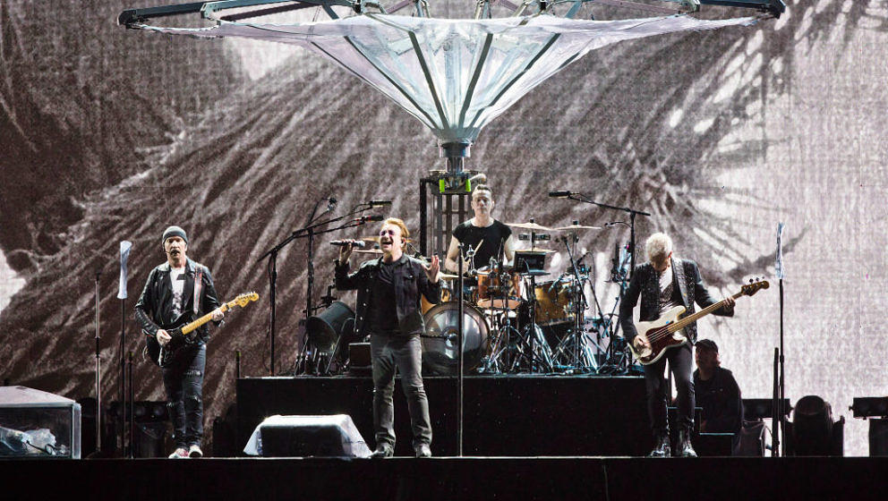 BERLIN, GERMANY - JULY 12: (L-R) The Edge, Bono, Larry Mullen Jr. and Adam Clayton of U2 perform live on stage during a conce