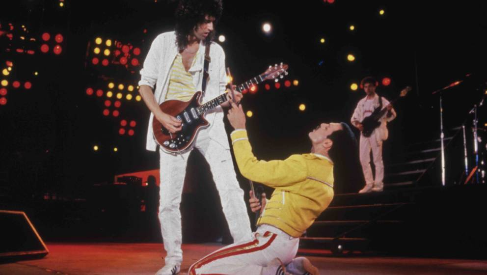 Singer Freddie Mercury (1946 - 1991) and guitarist Brian May of British rock band Queen in concert at Wembley Stadium, July 1