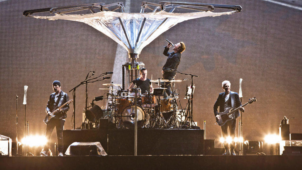 BERLIN, GERMANY - JULY 12: (L-R) The Edge, Larry Mullen Jr., Bono and Adam Clayton of U2 perform live on stage during a conce