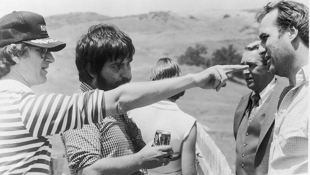 L-R: Producer (and uncredited director) Steven Spielberg points as director Tobe Hooper, actors James Karen and Craig T. Nels